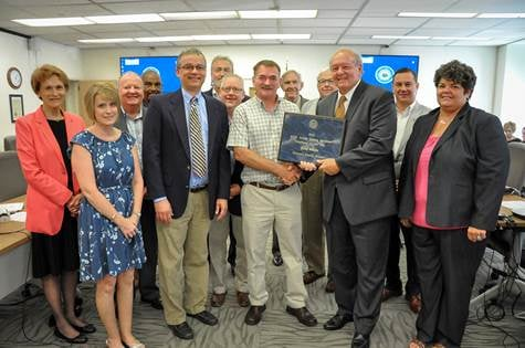 State Superintendent of Schools Dr. Steven Paine and West Virginia Board of Education members present the 2017 State Service Personnel Employee of the Year to Gary Wheeler, a custodian at Talcott Elementary in Summers County.