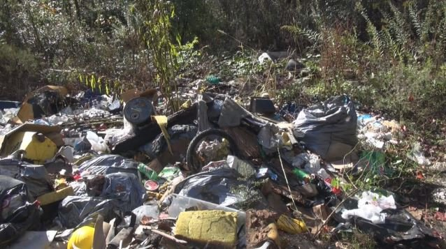 WV DEP helps clean up large open dumps around Mercer County