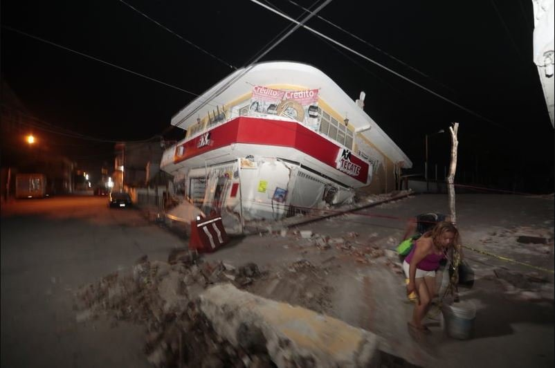 Image result for Mexicans race to save schoolgirl buried by quake; death toll at 237